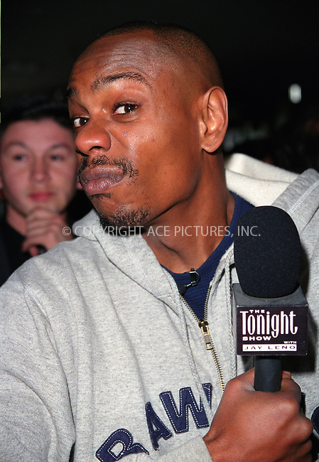 "Comedian and actor DAVE CHAPPELLE conducting interviews for the ""Tonight Show with Jay Leno"" in New York's Times Square. © 2002 by Alecsey Boldeskul/NY Photo Press.   ..*PAY-PER-USE*      ....NY Photo Press:  ..phone (646) 267-6913;   ..e-mail: info@nyphotopress.com"