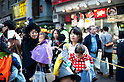 October 31, 2012, Tokyo, Japan - Japanese kids andmother pose for pictures during Kichijoji Halloween Festival 2012 near the Kichijoji station, Tokyo Japan. (Photo by Yumeto Yamazaki/AFLO)