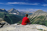 Enjoying a view of the Lewis Range of mountains in Glacier National Park after hiking to the top of Dawson Pass