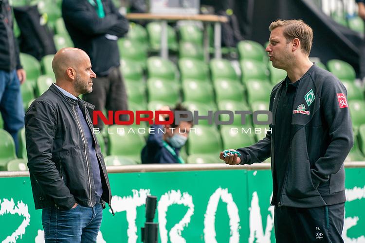 Florian Kohfeldt (Trainer SV Werder Bremen) re  Peter Bosz Trainer / Headcoach (Bayer 04 Leverkusen),<br /> <br /> Sport: Fussball: 1. Bundesliga: Saison 19/20: <br /> 26. Spieltag: SV Werder Bremen vs Bayer 04 Leverkusen, 18.05.2020<br /> <br /> Foto ©  gumzmedia / Nordphoto / Andreas Gumz / POOL <br /> <br /> Nur für journalistische Zwecke! Only for editorial use!<br />  DFL regulations prohibit any use of photographs as image sequences and/or quasi-video.
