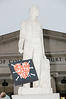 "A statue of Abraham Lincoln on E Street outside the District of Columbia Court of Appeals holds a protest sign reading ""I'm With Her"" after the 2017 Women's March on Washington in Washington DC on Jan. 21, 2017."