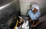 Relatives of a Palestinian Mohammed al-Taramsi who was shot dead by Israeli security forces, react at Indonesian hospital in the northern Gaza Strip August 18, 2019. Israeli forces last night killed three Palestinians and injured a fourth one in an artillery attack near the town of Beit Lahia, north of the Gaza Strip, according to the Ministry of Health. Photo by Mahmoud Ajjour
