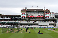 Players warm up ahead of the start of play which has been delayed owing to a wet outfield during Surrey CCC vs Kent CCC, Specsavers County Championship Division 1 Cricket at the Kia Oval on 7th July 2019