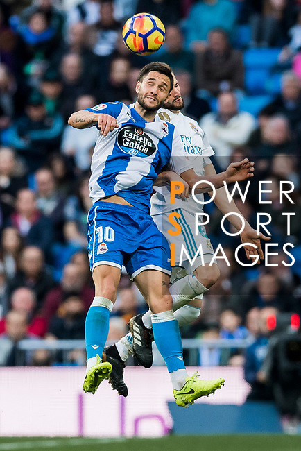 Florin Andone (L) of RC Deportivo La Coruna fights for the ball with Nacho Fernandez of Real Madrid during the La Liga 2017-18 match between Real Madrid and RC Deportivo La Coruna at Santiago Bernabeu Stadium on January 21 2018 in Madrid, Spain. Photo by Diego Gonzalez / Power Sport Images