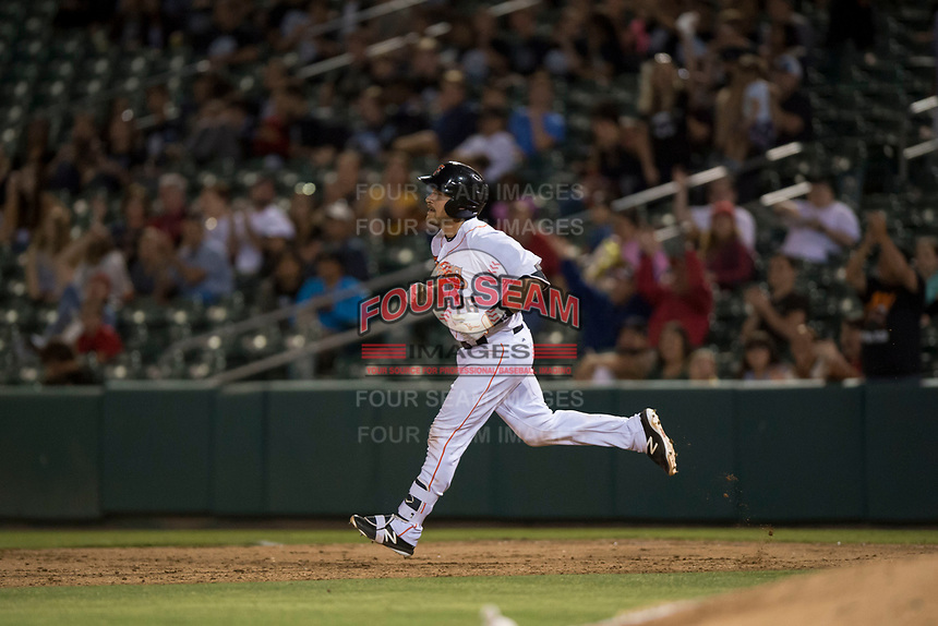 Fresno Grizzlies catcher Tim Federowicz (26) rounds the bases after hitting a home run during a Pacific Coast League game against the Salt Lake Bees at Chukchansi Park on May 14, 2018 in Fresno, California. Fresno defeated Salt Lake 4-3. (Zachary Lucy/Four Seam Images)