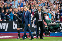 West Ham Utd Manager Manuel Pellegrini  turns from Man Utd manager Ole Gunnar Solskjær and celebrates at full time during the Premier League match between West Ham United and Manchester United at the Olympic Park, London, England on 22 September 2019. Photo by Andy Rowland / PRiME Media Images.