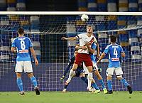 5th July 2020; Stadio San Paolo, Naples, Campania, Italy; Serie A Football, Napoli versus Roma; Edin Dzeko of AS Roma wins the header as he is held down by Manolas of Napoli