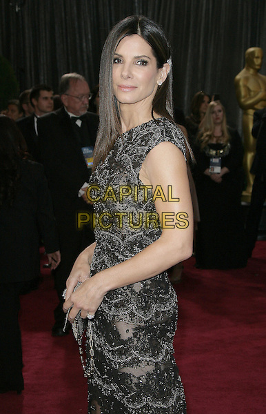 Sandra Bullock.85th Annual Academy Awards held at the Dolby Theatre at Hollywood & Highland Center, Hollywood, California, USA..February 24th, 2013.oscars half length black dress beads side beaded lace .CAP/ADM.©AdMedia/Capital Pictures.