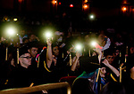 WATERBURY, CT-062017JS17- Some of the Waterbury Career Academy graduate hold up their cell phones like lighters at a concert, as the WCA Chorus sing &quot;Forever Young&quot; during graduation ceremonies Tuesday at the Palace Theatre in Waterbury. <br /> Jim Shannon Republican-American