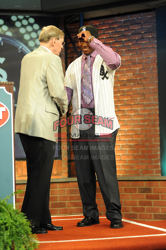 Outfielder Courtney Hawkins (Carroll H.S.) the number thirteen overall pick to the Chicago White Sox with MLB Commissioner Bud Selig during the MLB Draft on Monday June 04,2012 at Studio 42 in Secaucus, NJ.   (Tomasso DeRosa/ Four Seam Images)