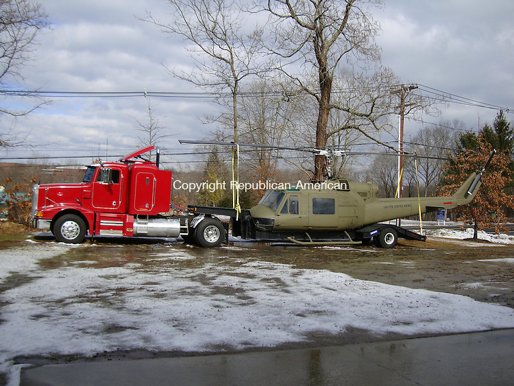 MIDDLEBURY, CT - 19 February 2009 - 021909MR01 - A Vietnam-era UH1M Huey helicopter is on display at the Golden Age of Trucking Museum on Southford Road.  The helicopter is on loan from Redding resident Andy Knapp, who restores military vehicles as a hobby. MATTHEW O'ROURKE