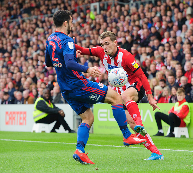 Lincoln City's Harry Toffolo vies for possession with Sunderland's Conor McLaughlin<br /> <br /> Photographer Chris Vaughan/CameraSport<br /> <br /> The EFL Sky Bet League One - Lincoln City v Sunderland - Saturday 5th October 2019 - Sincil Bank - Lincoln<br /> <br /> World Copyright © 2019 CameraSport. All rights reserved. 43 Linden Ave. Countesthorpe. Leicester. England. LE8 5PG - Tel: +44 (0) 116 277 4147 - admin@camerasport.com - www.camerasport.com