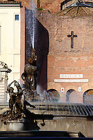 A view of the east side of piazza della Repubblica in Rome: a part of the Fountain of the Naiads by Mario Rutelli, on the background of the façade of the church of Santa Maria degli Angeli e dei Martiri (originally belonging to the baths of Diocleziano, designed by Michelangelo). In the center of the fountain is a Greek sea god. It was a sunny day and the water was flowing. Here the foreground of one of the nymphs (the Nymph of the Oceans, with her horse which symbolizes the sea) and of the central statue. Digitally Improved Photo.