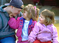 Uncle age 18 playing with nieces age 4 and 2.  St Paul Minnesota USA