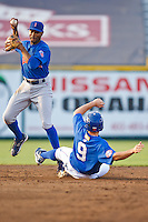 July 2nd, 2010 Bobby Scales (11) throws over sliding Kurt Mertins (9) during MiLB play between the Iowa Cubs and the Omaha Royals. Iowa Cubs won 5-3 at Rosenblatt Stadium, Omaha Nebraska.
