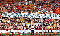 "Calcio: allenamento a porte aperte ""Open Day"" per la presentazione della Roma, a Roma, stadio Olimpico, 21 agosto 2013.<br /> AS Roma players face fans at the club's Open Day training session at Rome's Olympic stadium, 21 August 2013. The banner reads ""Inability to remedy a defeat is worse than the defeat itself"", referring to the Italy Cup final match lost agains Lazio's city rivals, on last 26t May.<br /> UPDATE IMAGES PRESS/Riccardo De Luca"