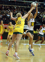 25.10.2012 Australia's Caitlin Thwaites and South Africa's Vanes-Mari Du Toit in action during the England v Australia netball test match as part of the Quad Series played at the TSB Arena Wellington. Mandatory Photo Credit ©Michael Bradley.