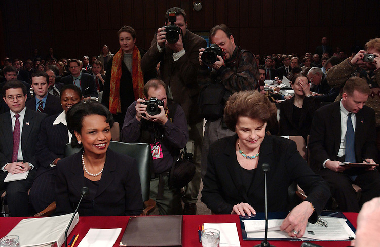 01/18/05.RICE/SECRETARY OF STATE NOMINATION--Condoleezza Rice, and Sen. Dianne Feinstein, D-Calif., are surrounded by photographers as they take their seats before the Senate Foreign Relations confirmation hearing on Rice's nomination to be secretary of State. Feinstein introduced Rice..CONGRESSIONAL QUARTERLY PHOTO BY SCOTT J. FERRELL