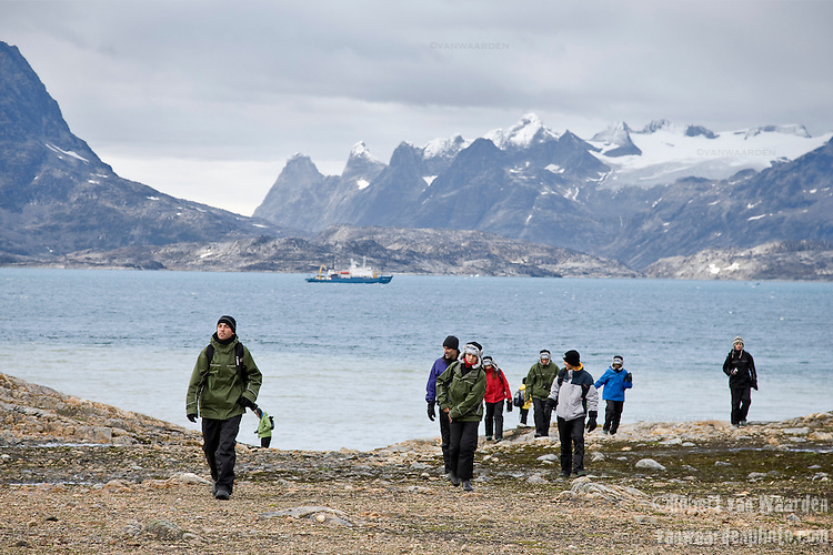 Students explore the coast of Greenland whilst on a landing to discover the local geography and glaciers. The ship waits in the background.