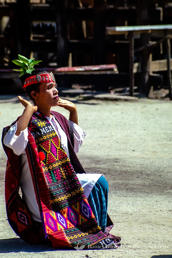 Indonesia, Sumatra. Samosir. Simanindo on the northern tip of Samosir is the cultural center of Samosir, with a museum. Batak dance performance. Batak dancer wearing traditional Batak textiles.