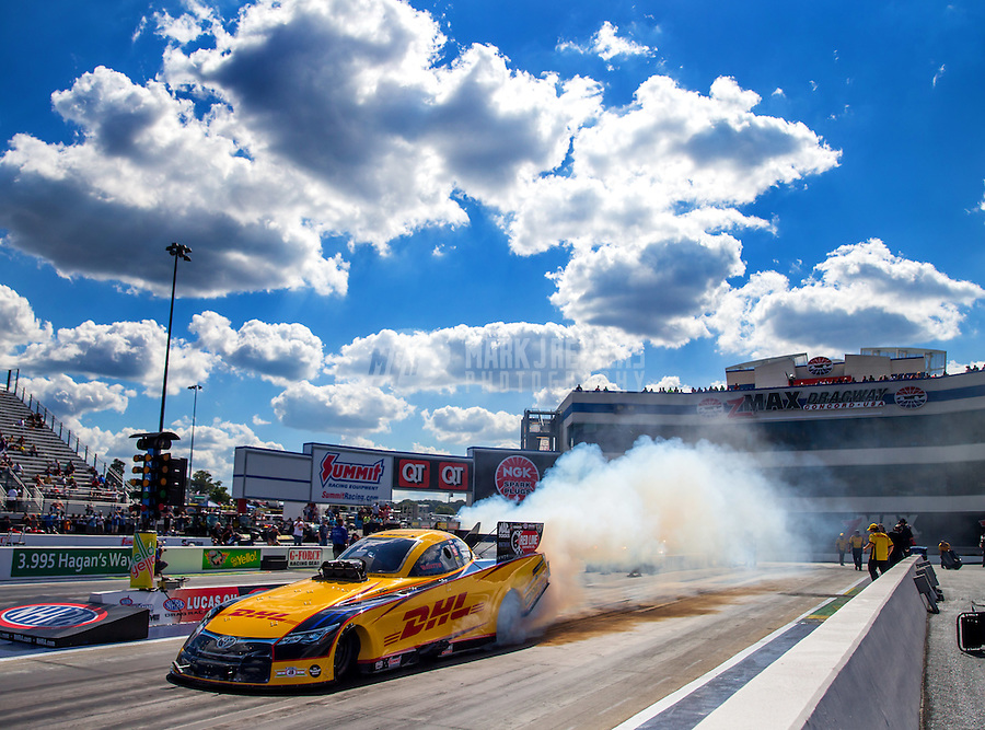 Sep 19, 2015; Concord, NC, USA; NHRA funny car driver Del Worsham does a burnout during qualifying for the Carolina Nationals at zMax Dragway. Mandatory Credit: Mark J. Rebilas-USA TODAY Sports