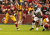 Washington Redskins running back Adrian Peterson (26) carries the ball in the first quarter against the Philadelphia Eagles at FedEx Field in Landover, Maryland on December 30, 2018.  He is pursued by Philadelphia Eagles outside linebacker Nigel Bradham (53).<br /> Credit: Ron Sachs / CNP