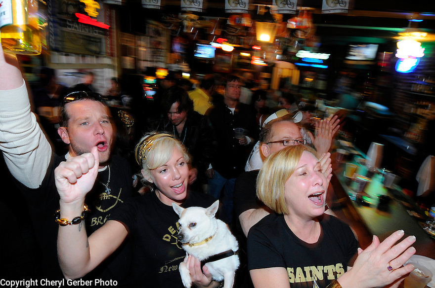 New Orleans Saints fans Matthew Kremer, Mignon Parent, Tulip, and Melanie Rhinehart celebrate the kickoff of NFC Championship game against the Minnesota Vickings at Harry's Corner in the French Quarter,  New Orleans, Sunday, Jan. 24, 2010..(AP Photo/Cheryl Gerber)