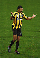 Phoenix striker Paul Ifill is baffled by a refereeing decision during the A-League football match between Wellington Phoenix and Perth Glory at Westpac Stadium, Wellington, New Zealand on Sunday, 16 August 2009. Photo: Dave Lintott / lintottphoto.co.nz