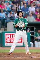 Austin Dean (2) of the Greensboro Grasshoppers checks his bat before stepping up to the plate against the Hagerstown Suns at NewBridge Bank Park on June 21, 2014 in Greensboro, North Carolina.  The Grasshoppers defeated the Suns 8-4. (Brian Westerholt/Four Seam Images)