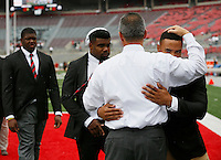 Ohio State Buckeyes head coach Urban Meyer hugs running back Jalin Marshall prior to the NCAA football game against Northern Illinois at Ohio Stadium in Columbus on Sept. 19, 2015. (Adam Cairns / The Columbus Dispatch)