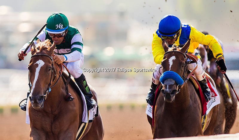 ARCADIA, CA - JUNE 03: Stellar Wind #2 with Victor Espinoza up defeats Vale Dori #1 and Rafael Bejarano to win the Beholder Mile Stakes at Santa Anita Park  on June 03, 2017 in Arcadia, California. (Photo by Alex Evers/Eclipse Sportswire/Getty Images)