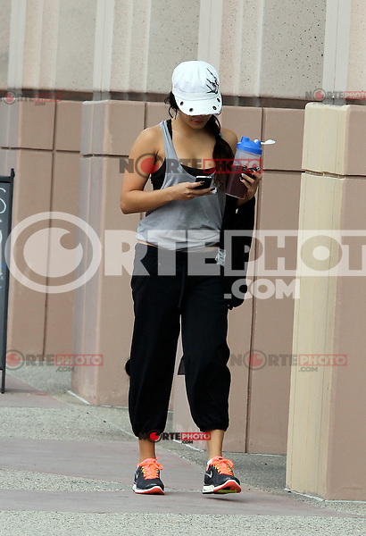 Vanessa Hudgens stays in shape and leaves a gym in Los Angeles, California on 03.05.2012. Vanessa carries an eco friendly bottle and texts busy on her cell phone to avoid the eye contact with the waiting photographers..Credit: Correa/face to face. /MediaPunch Inc. ***FOR USA ONLY***