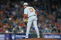 Texas Longhorns starting pitcher Bryce Elder (13) looks to his catcher for the sign against the LSU Tigers in game three of the 2020 Shriners Hospitals for Children College Classic at Minute Maid Park on February 28, 2020 in Houston, Texas. The Tigers defeated the Longhorns 4-3. (Brian Westerholt/Four Seam Images)