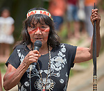 A woman speaks to the crowd as indigenous people march through the streets of Atalaia do Norte in Brazil's Amazon region on March 27, 2019, protesting a central government plan to turn control of health care over to municipalities, in effect destroying a federal program of indigenous health care. Indian rights activists are worried that the government of President Jair Bolsonaro is reducing or eliminating protections for the country's indigenous people.