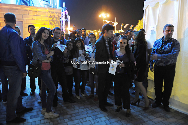 Fans of Emin Agalarov, the son-in-law of Azerbaijan's President Ilham Aliyev and the nation's top male pop star, wait backstage to see him after a performance on the Caspian seaside Bulvar at the Eurovsion Song Contest Fan Club concert on April 29, 2012.  Agalarov is married to Leyla Aliyeva, the eldest daughter of Azerbaijani President Ilham Aliyev who holds many hats in her own right, among them head of the Heydar Aliyev Foundation in Russia, editor of Baku Magazine, artist, and poet and Agalarov's father, Aras Agalarov, is a Russian billionaire oligarch of Azerbaijani origin in the retail and real estate development sectors, being the first to bring foreign luxury fashion brands to Russia after the collapse of communism and opening several gaudy malls and arenas in Moscow and elsewhere in Russia.