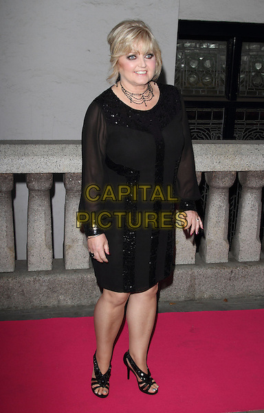 Linda Nolan<br /> The Inspiration Awards For Women 2013, Cadogan Hall, Sloane Terrace, London, England.<br /> October 2nd, 2013<br /> full length black dress sheer<br /> CAP/ROS<br /> &copy;Steve Ross/Capital Pictures