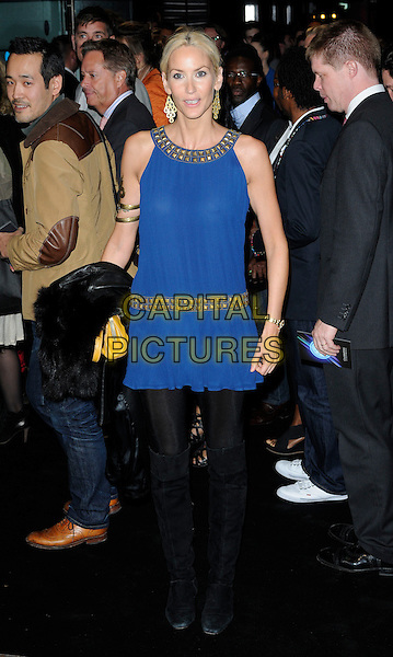 LISA BUTCHER .Attending the Ozwald Boateng Fashion Show during the final day of London Fashion Week, Odeon cinema Leicester Square London, England, UK,.September 22nd 2010..full length blue gold dress arm bangle bracelet studded studs neckline black tights .CAP/CAN.©Can Nguyen/Capital Pictures.