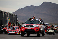 Mar 29, 2014; Las Vegas, NV, USA; NHRA pro stock driver Erica Enders-Stevens (right) celebrates with the winner of the Toyota truck after winning the K&N Horsepower Challenger during the Summitracing.com Nationals at The Strip at Las Vegas Motor Speedway. Mandatory Credit: Mark J. Rebilas-