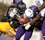 MANKATO, MN - NOVEMBER 1:  Nephi Garcia #3 for the University of Sioux Falls is brought down by Tyler Henderson #33 and Shonquille Dorsey #55 from Minnesota State Mankato in the first quarter Saturday afternoon at Blakeslee Stadium in Mankato. (Photo by Dave Eggen/Inertia)