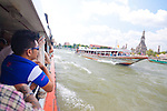 Chao Phraya River, Bangkok, Thailand. Riding the Orange Flag Express Boat offers views of many landmarks, including Wat Arun.