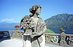 Statue of a woman looks out from the Balbianello Villa over Lake Como in northern Italy.