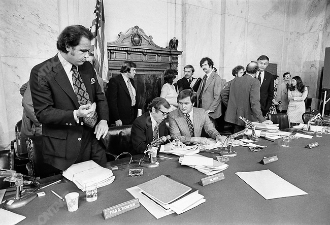 Fred D. Thompson, Senate Watergate investigator, left, with Sen. Howard Baker, center, at a break during the Watergate hearings on Capitol Hill. John Dean was testifiying that day. Investigator Arthur Lyman is seen standing at rear. Washington, D.C., August 1973.