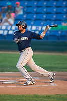 Jay Feliciano (15) of the Helena Brewers follows through on his swing against the Great Falls Voyagers at Centene Stadium on August 18, 2017 in Helena, Montana.  The Voyagers defeated the Brewers 10-7.  (Brian Westerholt/Four Seam Images)