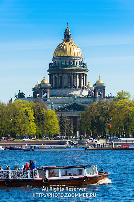 St. Isaak's Cathedral and tour boat in Saint Petersburg, Russia