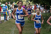 Notre Dame's Jordan Meadors (left) and Alaina Baumgart (right) run the final mile of the 3A varsity girls 5k at the 2014 Hancock Cross Country Invitational in St. Louis, MO. Saturday, September 27. Baumgart finished 15th in 21:27 while Meadors was just behind in 17th place, finishing in 21:31, leading Notre Dame to a fourth-place finish in the 17-team race.