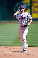 Trentt Copeland (14) of the Evansville Purple Aces throws to first base during a game against the Indiana State Sycamores in the 2012 Missouri Valley Conference Championship Tournament at Hammons Field on May 23, 2012 in Springfield, Missouri. (David Welker/Four Seam Images)