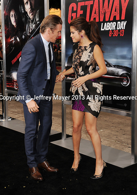 WESTWOOD, CA- AUGUST 26: Actors Ethan Hawke (L) and Selena Gomez arrive at the 'Getaway' - Los Angeles Premiere at Regency Village Theatre on August 26, 2013 in Westwood, California.