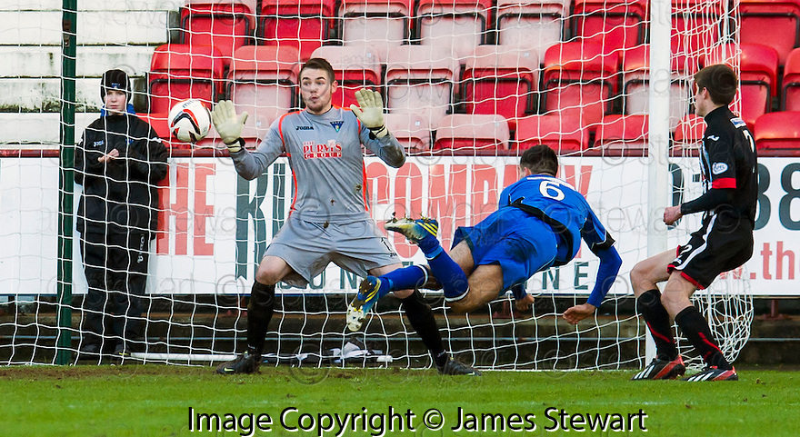Stranraer's Steven Bell scores their first goal.