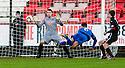 Stranraer's Steven Bell scores their first goal.
