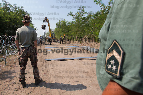 A second line of border fence is being built behind a NATO barbed wire fence to stop illegal migrants entering on the green border between Serbia and Hungary near Asotthalom (about 190 km South of capital city Budapest), Hungary on August 13, 2015. ATTILA VOLGYI